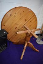 A modern pine circular extending dining table