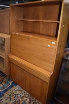 A mid Century part teak bureau bookcase of stylised form, width approx. 91cm