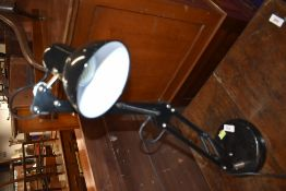 A traditional angle poise lamp