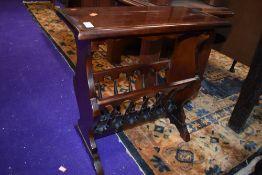 A reproduction mahogany magazine table