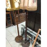 Two mahogany standard lamps