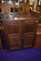A late 19th/early 20th Century Art Nouveau oak side cabinet in the Liberty style