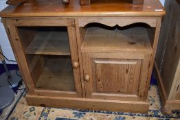 A natural pine entertainment or similar cabinet