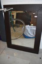 A modern leatherette wall mirror, approx. 69 x 90cm