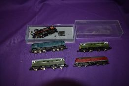 Four Lima, Fleischmann Piccolo and Trix N gauge Diesel Locomotives and a similar Southern pacific