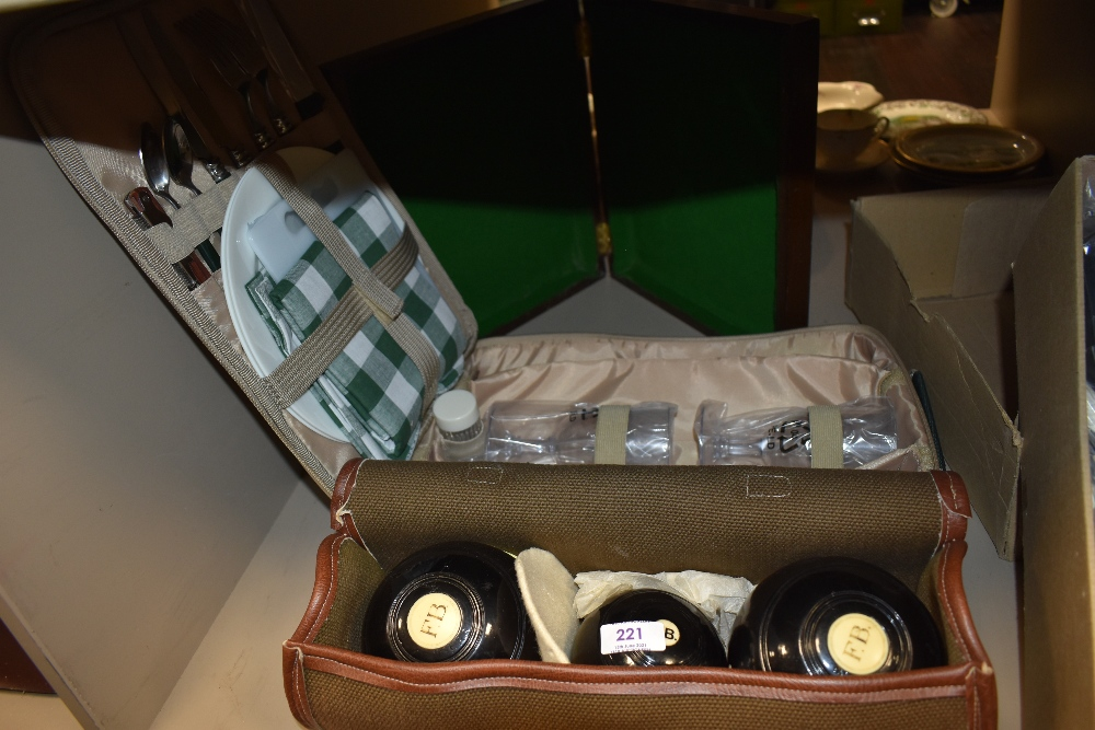 A set of crown green bowls by Slazengers bias 2 1/2 and picnic set