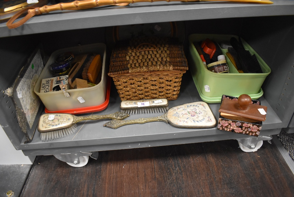 A miscellany of items including dressing table items, sewing basket, shoe brushes and more.