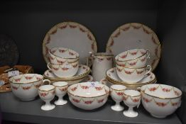 A partial Wearing and Gillow tea service comprising of egg cups,cups and saucers,jug and plates