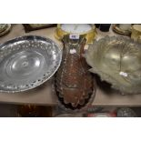 A selection of metal wares including fish shaped moulds and pressed leaf dish