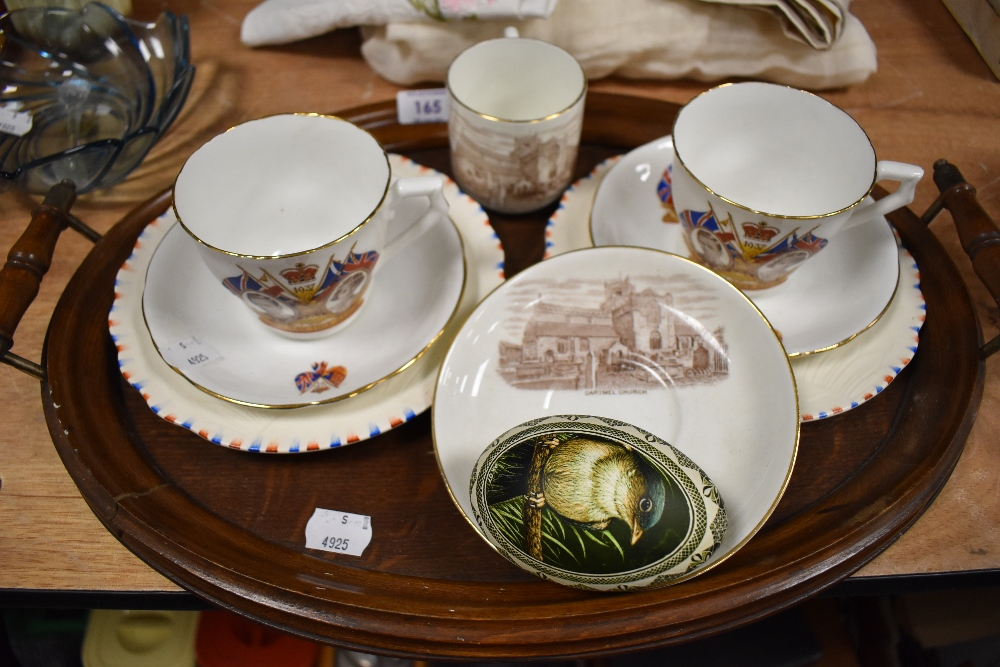 An antique wooden tray and a selection of commemorative ware.