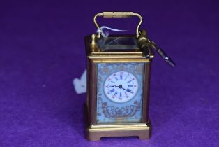 A miniature brass carriage clock,probably 19th century French,having hand painted countryside and