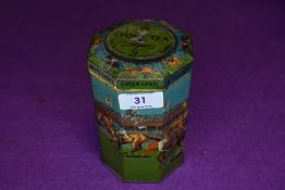 A vintage novelty octagonal shaped Grand National game tin, with lid having a spinning top,which