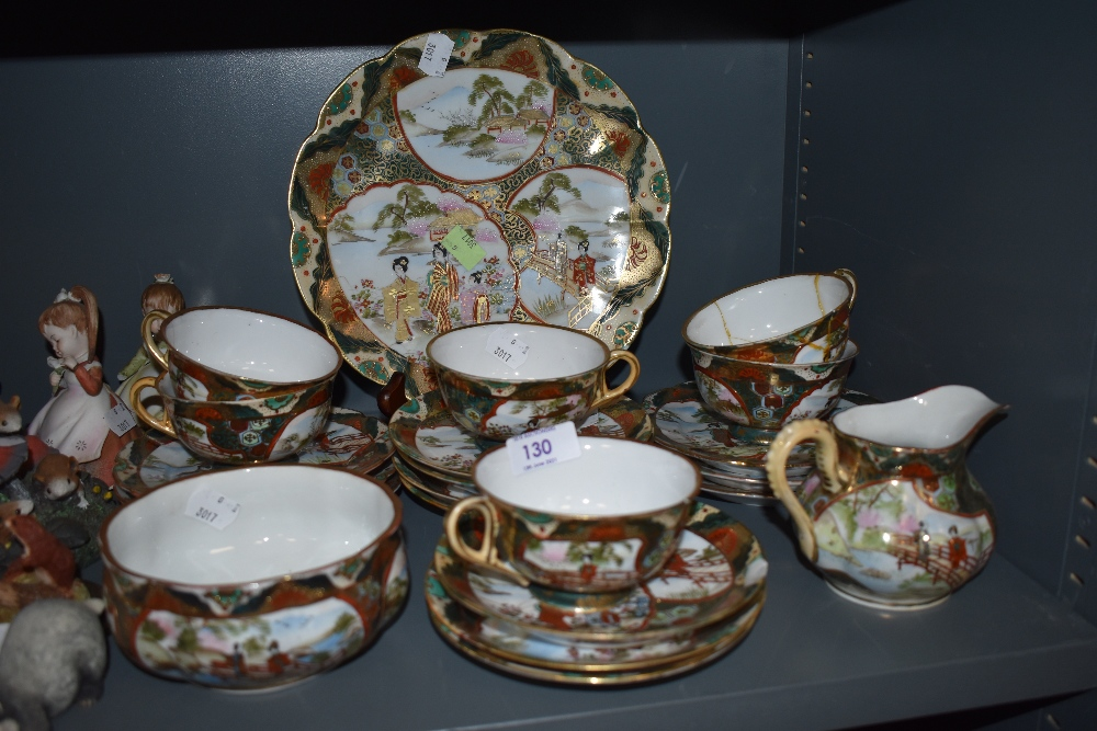 A collection of oriental cups and saucers,sugar basin and plates.AF
