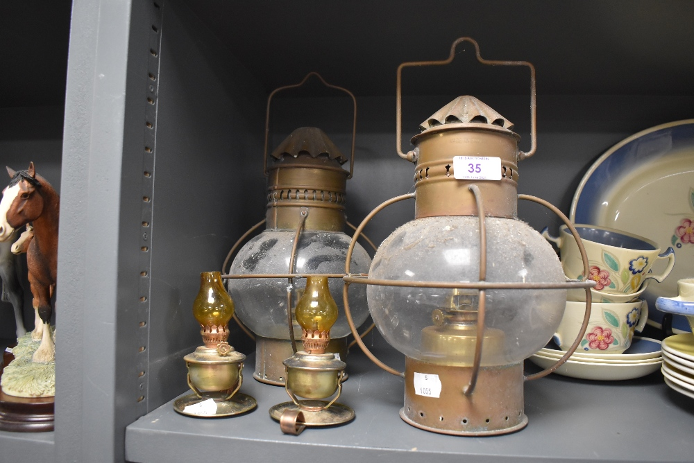 An assortment of oil lamps/storm lamps.