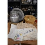 A small vintage aluminium milk churn/billy can,awooden riddle and a selection of vintage table linen