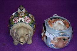 A vintage Chinese novelty tea pot having different masks/faces to each side,wicker handle not