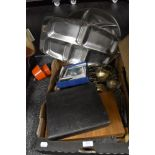 A box of mixed flatware a silver plated photo frame, canteens if cutlery and more.