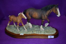 A Border Fine Arts study, New Arrival At Harland Grange, Clydesdale Mare and Foal, Modeller