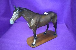 A Beswick study, Large Racehorse, brown, model no 1564, fixed to a home made plinth