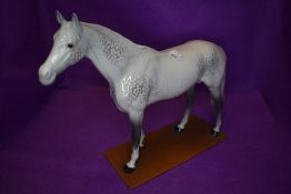 A Beswick study, Large Racehorse, grey, model no 1564, fixed to a home made plinth