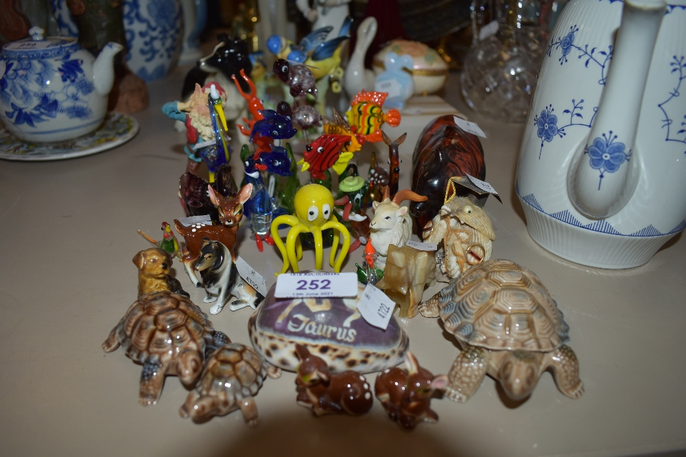 A selection of figurines and small glass miniatures including sea life and fish interest