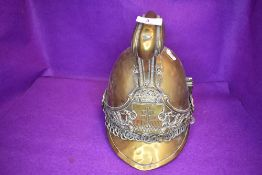 A late 19th/early 20th century French fire fighters brass helmet ' Pompiers D'ypres' no lining