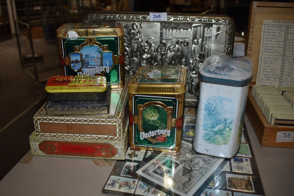 A selection of advertising tins and a set of stamps with Kew garden interest
