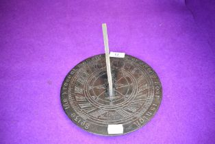 A bronze sundial,with a pierced gnomon,signed and dated 'Thomas Grice 1705'with inscription