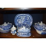 A mixed lot of blue and white ware including tureens and platters.
