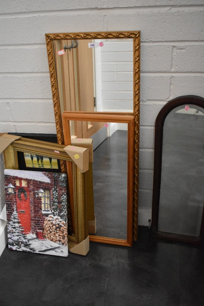 A selection of prints and picture frames including mirrors