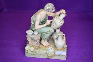 A Royal Dux figure of seated ceramics painter.