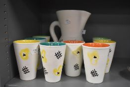 A mid century Vallauris lemonade set designed by Andre Baud, having cream ground with abstract