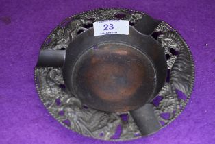 A vintage Japanese ashtray having tiger, blossom,chrysanthemums and dragon.