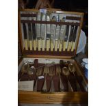 A golden oak cased canteen of cutlery by Cooper Bros and Sons