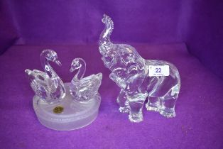 A Royal Crystal rock swan figurine and Waterford Crystal elephant