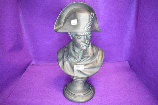 A heavy bronze effect bust of Napoleon.