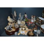 An assortment of animal figurines and similar.