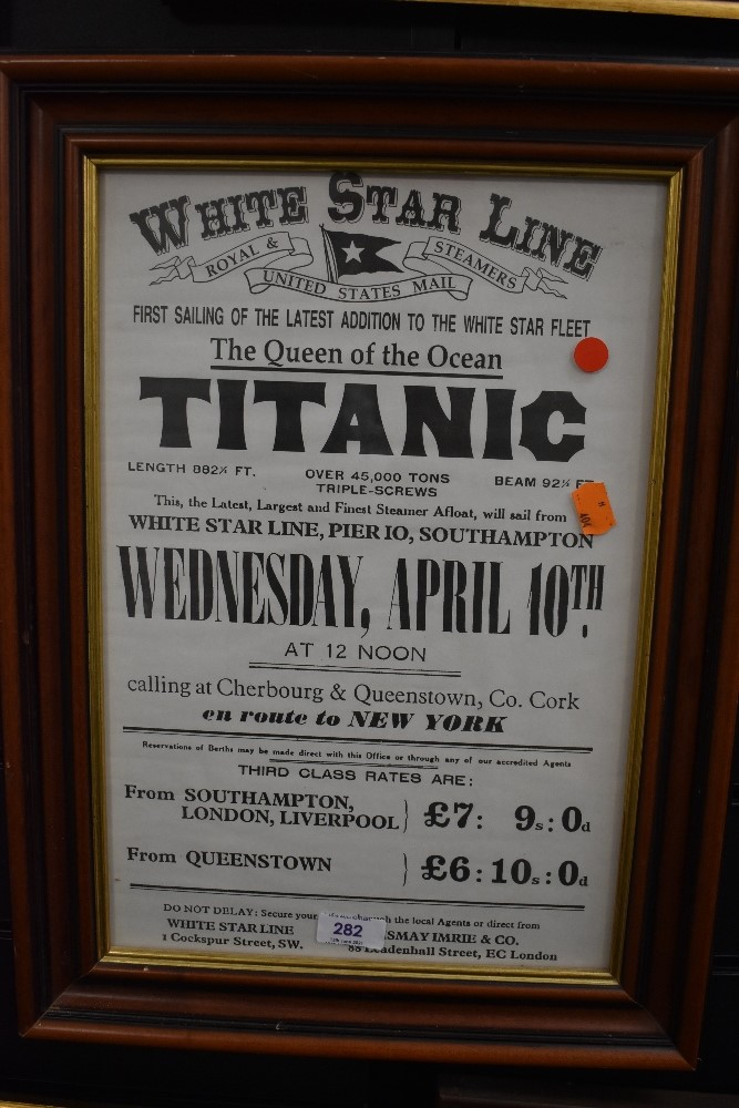 A reproduction white star line poster for the Titanic framed and glazed