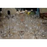 A selection of kitchen and table ware glass including sherry and wine etc