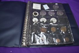 A Coin Album containing mainly GB and Roman Coins including 1853 Farthing, 1841 Halfpenny, 1841