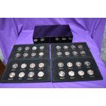 A cased set of 32 restrike Jean Dassier bronze effect Medallions, William I - George II, Monarchs of