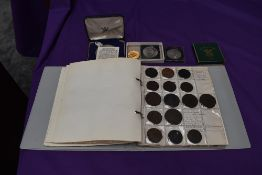 An album of GB Tokens mainly copper and bronze, approx 78 tokens, most in good condition, along with