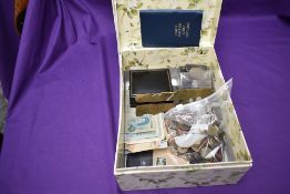 A collection of GB and World Coins and Banknotes, a pack of GB 1st Class Stamps and a brass military