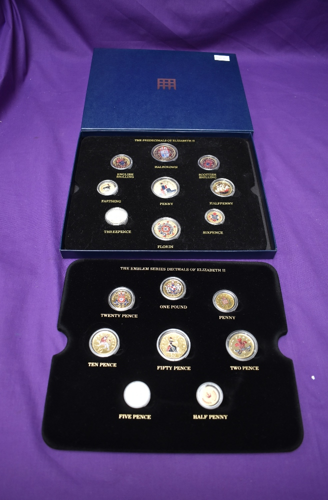 A box of GB Coins coining two sets of Queen Elizabeth II Coins, both gold plated and colour