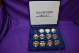 A part set of The Legendary Aircraft Collection of Brass Coins in display case, 11 coins in total