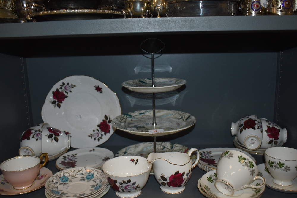 A mixed lot of general ceramics including cups and saucers and cake stand with three tiers.