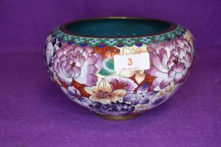 A cloisonne bowl in a millefiori pattern on red and purple ground 20cm wide