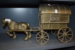 A large brass cast figure of a shire horse and gypsy caravan