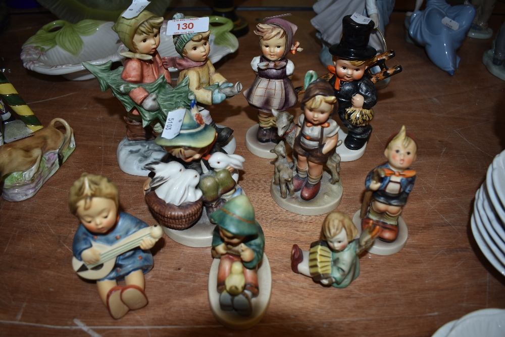 Nine Goebel figures including Tree Trimming Time BH12, Good Friends, Chimney Sweep Boy, Boy with