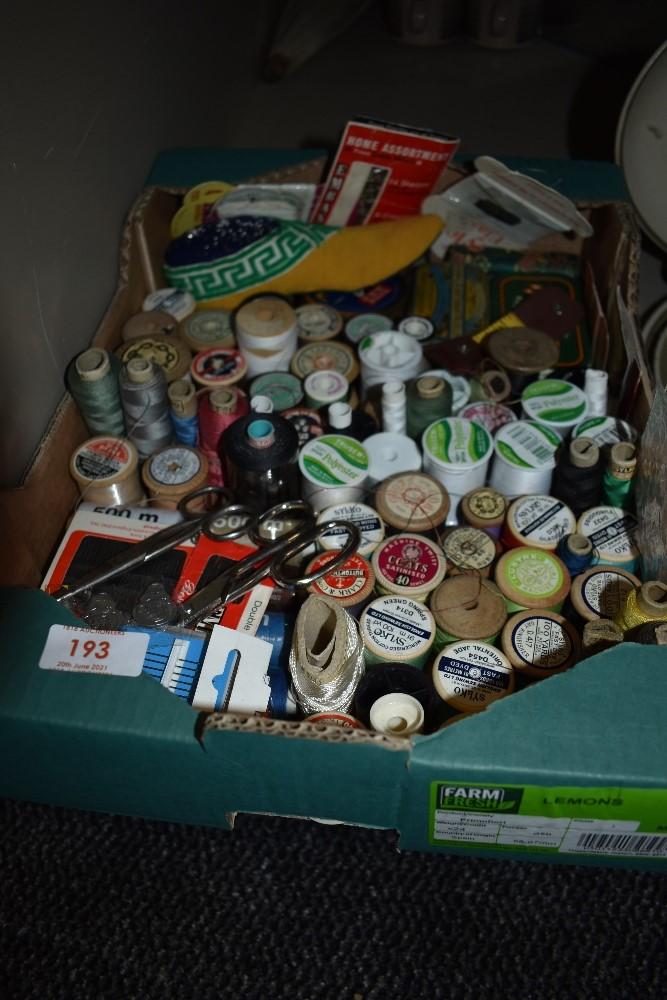 A box full of predominantly vintage haberdashery including vintage and antique cotton reels,